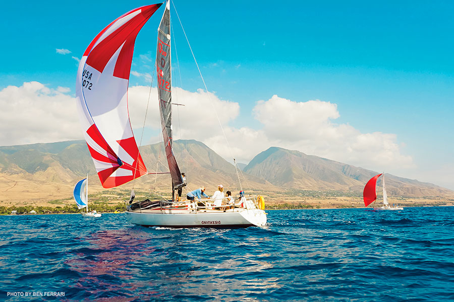 With West Maui's mountain as backdrop, Cosco Carlbom takes a turn captaining Lahaina Yacht Club's boat, Snickers, during the first regatta of the season.