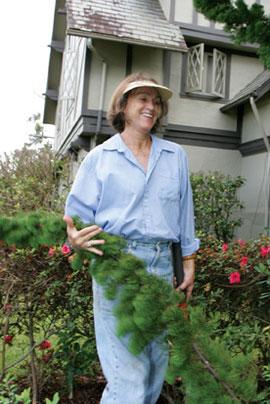 Judy Bisgard cradles a bough of greenery.