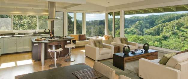 Away from the walls, chairs and sofas turn a large room into several intimate seating areas—each with great access to views.