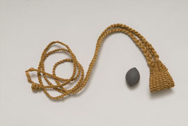 Weapons such as this ma'a (sling) and ma'a ala (sling stone) made by Raymond Nakana require excellent weaving skills.